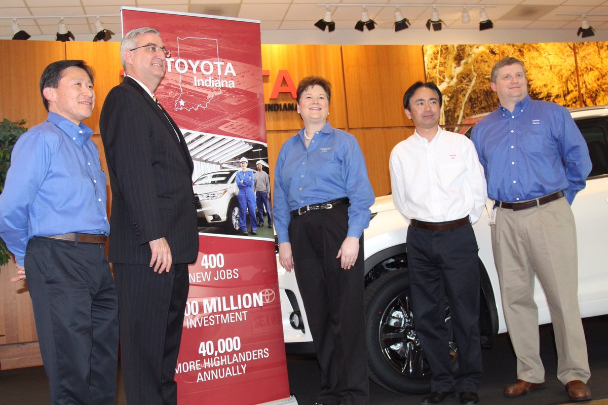 Republican Governor Eric Holcomb (right) joined in the Toyota investment announcement.