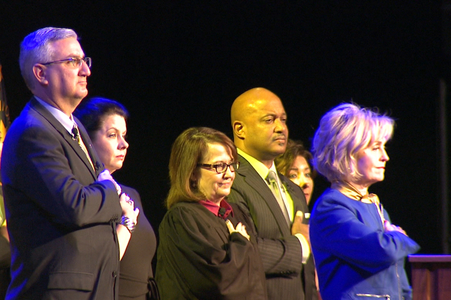 Eric Holcomb (left) and other statewide officials were sworn into office Monday.