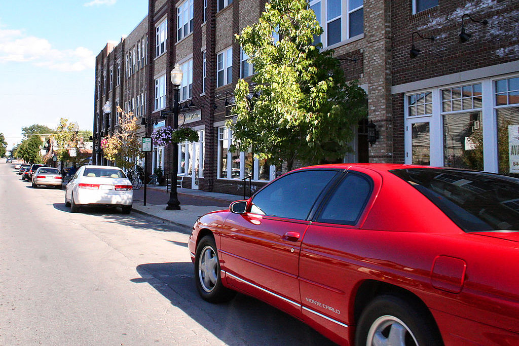 A red car on the streets of downtown Carmel, Indiana.