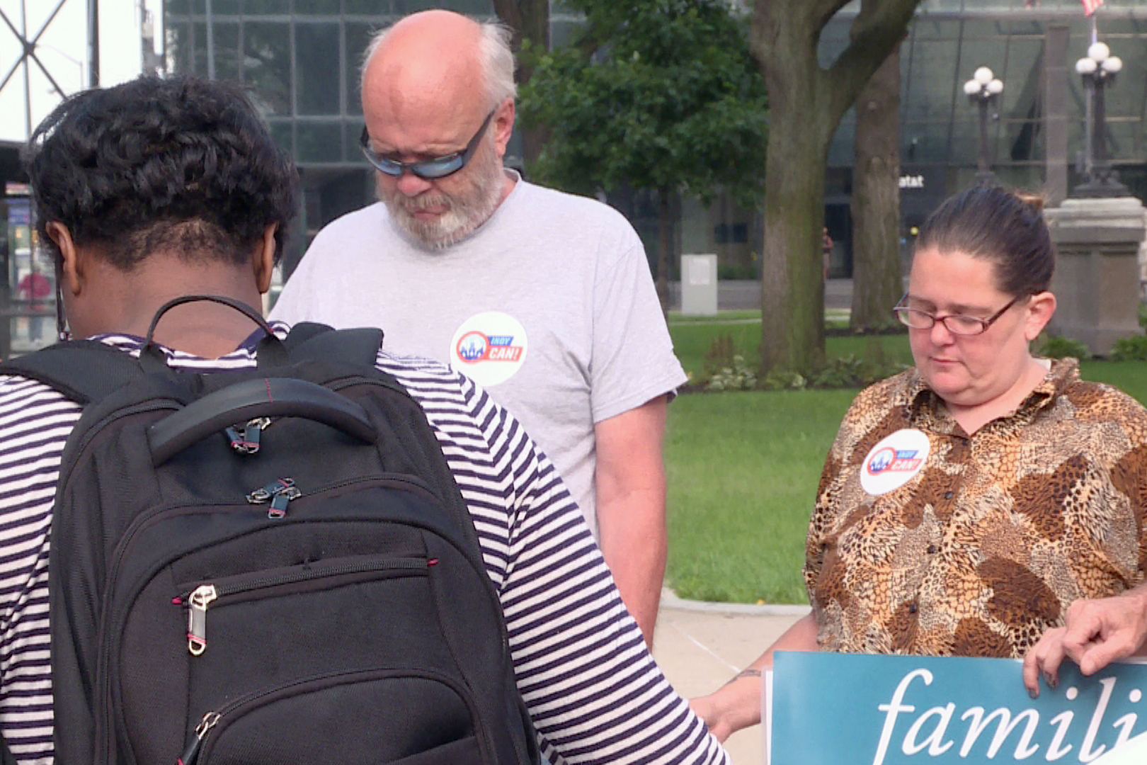 Affordable Care Act repeal protesters pray during a rally outside Senator Todd Young's office.