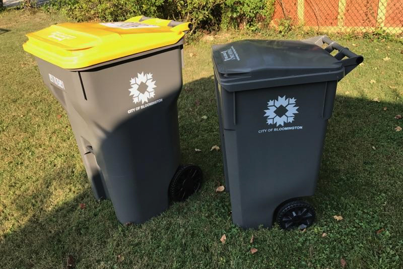 The new carts for trash and recycling are differentiated by a yellow lid for recyclables.