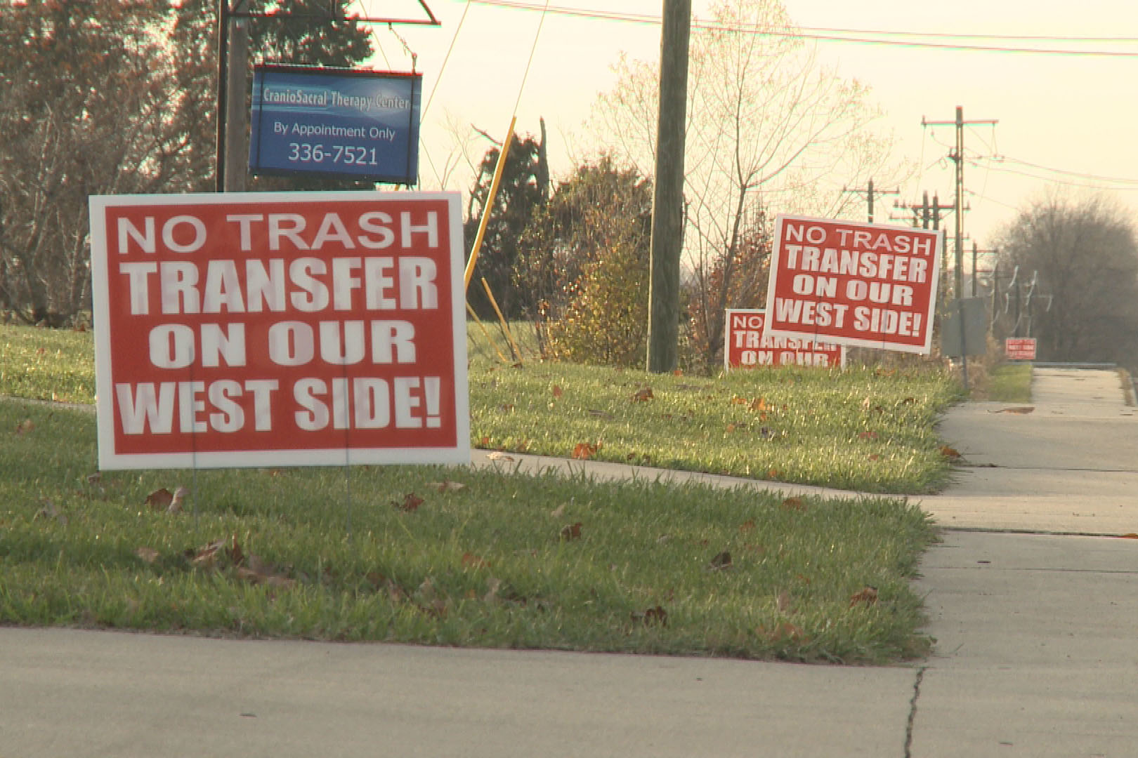 Signs lining a street on Bloomington's west side protest the proposed facility.