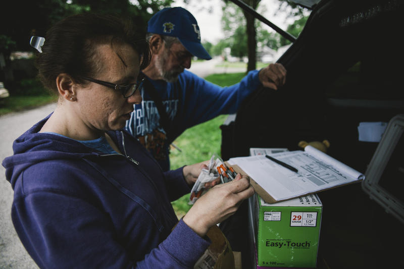 Brittany Combs of Scottsburg, Indiana an employ of the Scott County Health Department makes her weekly stop with the mobile unit at Jerry Penningtons home in Austin, Indiana to exchange needles. Jerry is apart of of the needle exchange program, the program sees new users sign up weekly.