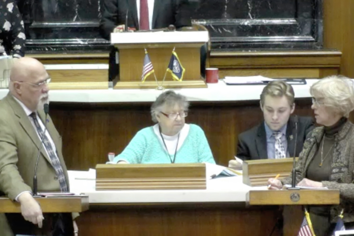 Reps. Tim Brown (R-Crawfordsville) and Sue Errington (D-Muncie) discuss the to-be-appointed Muncie school board on the House floor Wednesday evening.