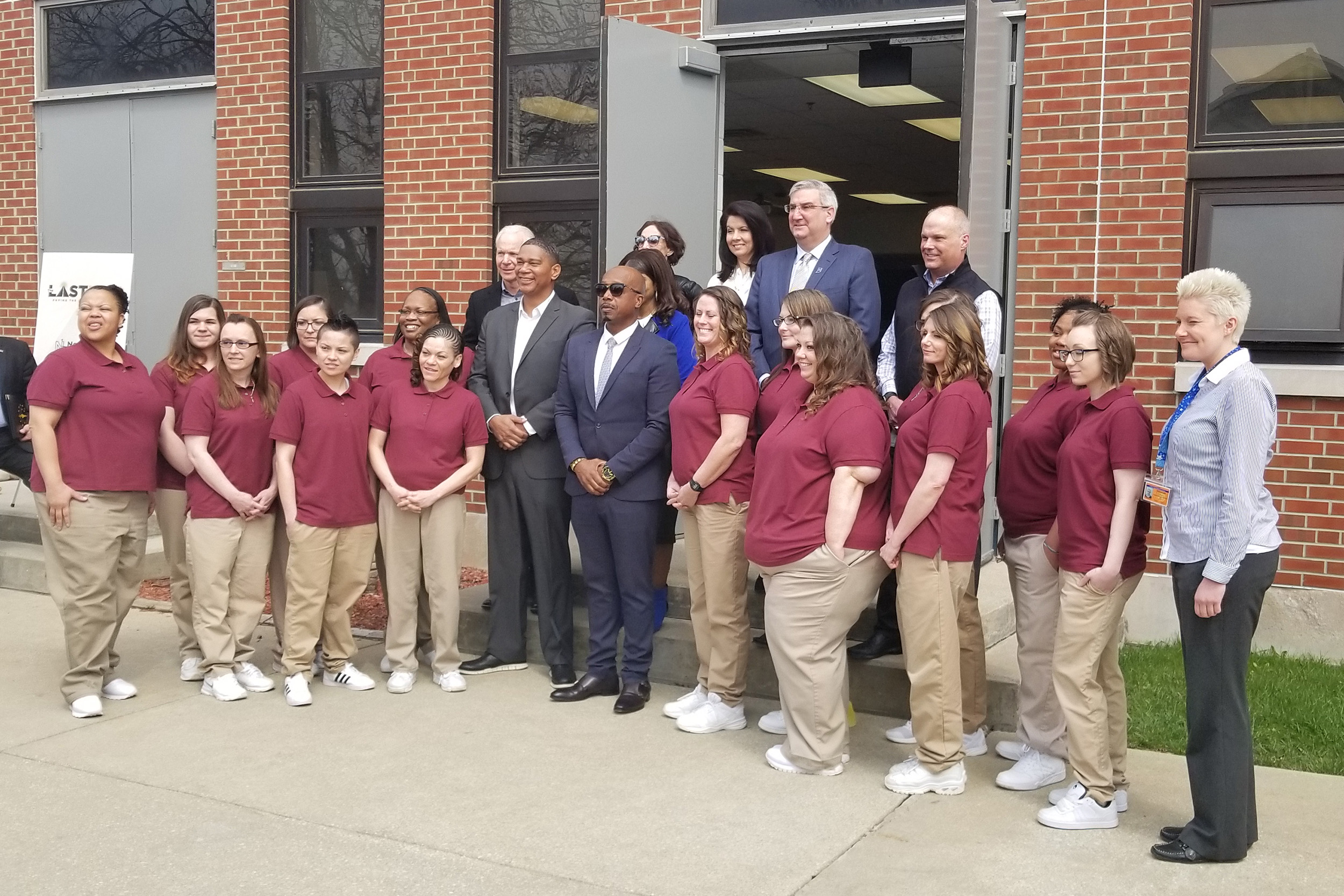 The inaugural class gets a picture with MC Hammer, Gov. Eric Holcomb and others to commemorate the day. (Samantha Horton/IPB News)