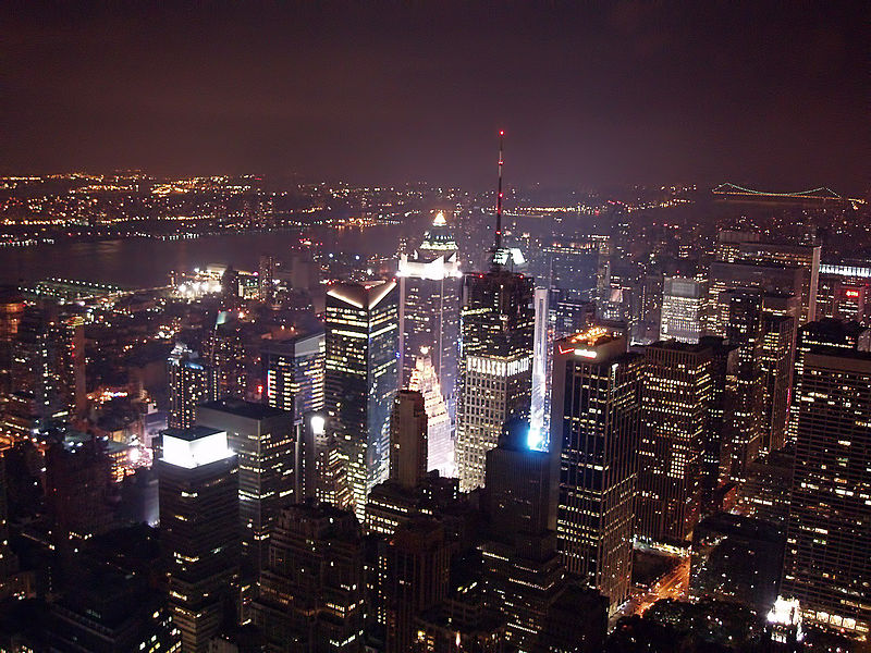 A view of Times Square and New York City at night from atop the Empire State Building.