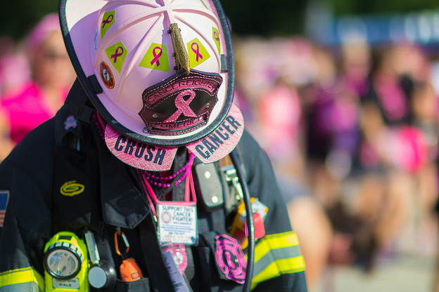 Firefighter show his support for breast cancer.