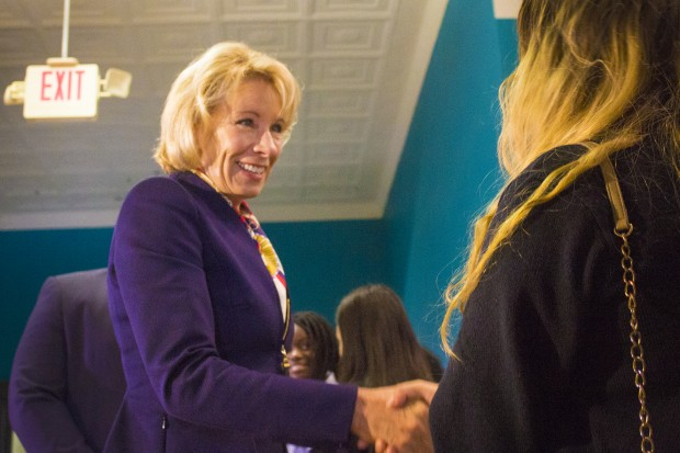 In this May 23, 2017 photo, DeVos visits Providence Cristo Rey High School in Indianapolis.