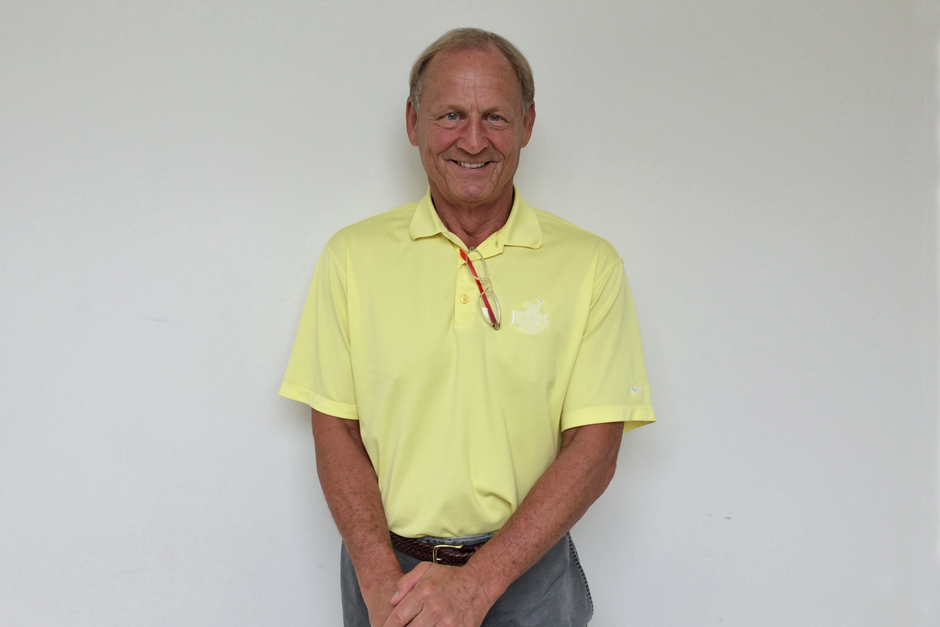 Don Fischer in yellow polo shirt