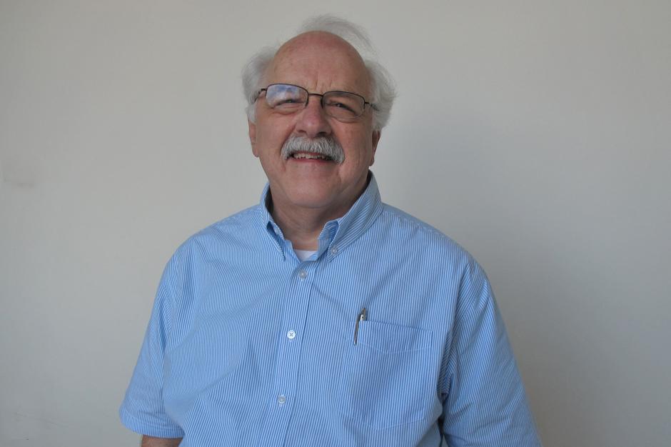 Joe Bourne in glasses, blue and white short-sleeved shirt