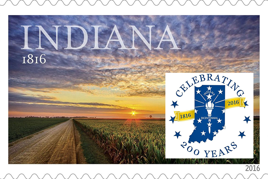 The 20a6 Indiana Bicentennial stamp showing a road and farmlands at sunset, with the logo of Indiana's Bicentennial superimposed.
