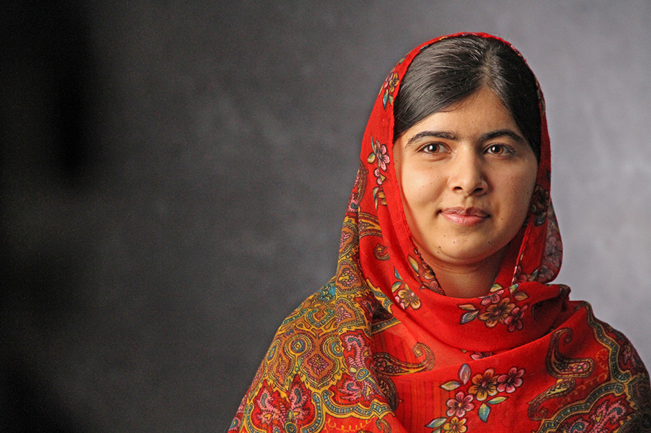 Malala Yousafzai wearing red headscarf that partially covers her hair