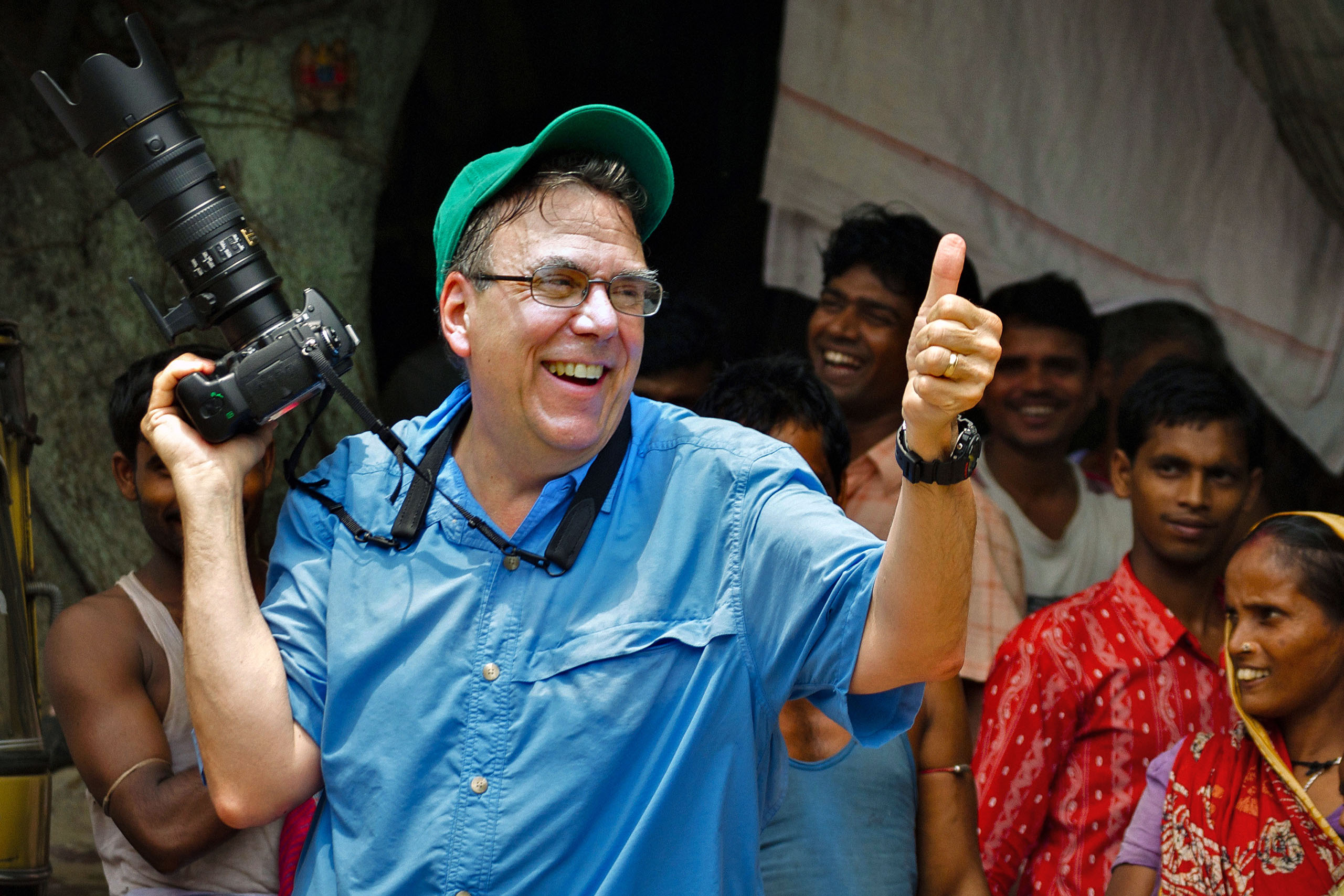 Photojournalist Steve Raymer with residents of Calcutta, India's former British colonial capital (Photo courtesy of Joseph Breen)
